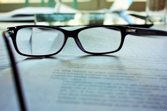 Image of eyeglasses on top of a document
